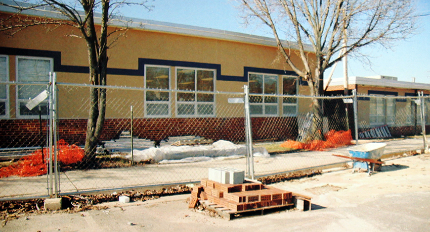 Picture of the front exterior of Navy Elementary School during renovation. The picture was printed in the school's 2006 yearbook.