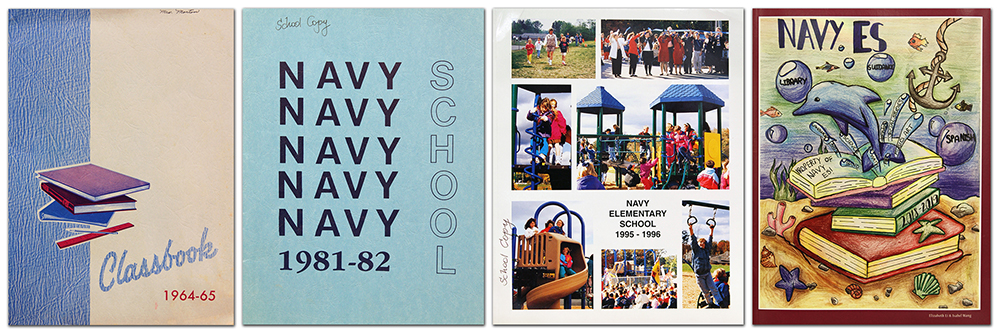 Photograph of the covers of four Navy Elementary School yearbooks.